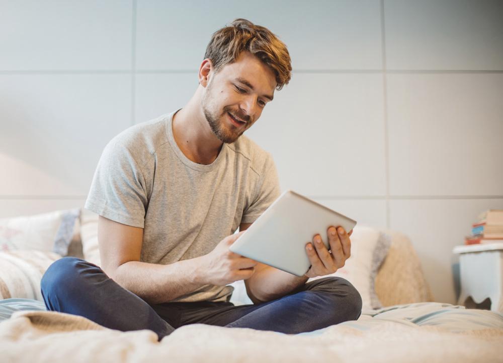 man reading in room